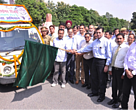 The awareness vehicle being flagged off by the chief guest and other participants before its departure to Pilibhit