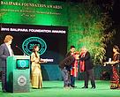 Members of the Pangchen Lakhar Community Conserved Area Management Committee accept the Balipara Foundation Award 2015 for their work in conserving community-owned forests
