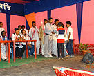 Students getting awarded at the Rongali Bihu Basanta