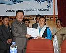 Ms. Rinzing Doma, President, Tsomgo Pokhri Sanrakshan Samiti receiving the Best NGO Award from the Honourable Chief Minister of Sikkim Dr. Pawan Kumar Chamling.