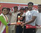 WWF-India distributing a trophy to the 'man of the match