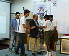 Mr Ravi Singh, Secretary General and CEO hands over prizes to the winners