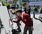 Participants during a painting competition on the World Water Day in Gangtok