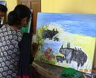 Artists showcasing their paintings during the Rhino Day celebrations in Kaziranga National Park