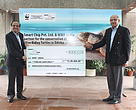 Mr. Sanjeev Shriya, Managing Director, Smart Chip Private Limited presenting a pledge cheque to Mr. Karan Bhalla, Chief Operating Officer, WWF-India at the partnership event